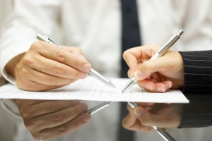 business owners signing buy sell agreement